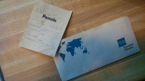 A pamida receipt for eyeglasses and a travelers check envelope. OOoooh. So they went on a trip, did they?