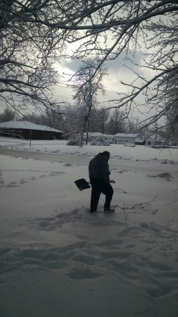 Hubby scoops the snow (you can't tell it now, poor guy)